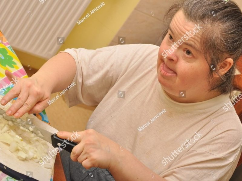 stock-photo--attractive-down-syndrome-woman-cocking-in-the-kitchen-47697124